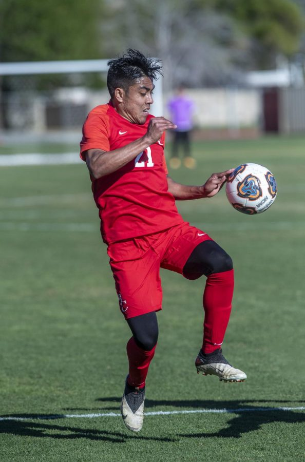 Number 21 on Bakersfield College's men's soccer team sophomore Juan Agripino playing his position as a wide midfielder during the Spring 2021 season.