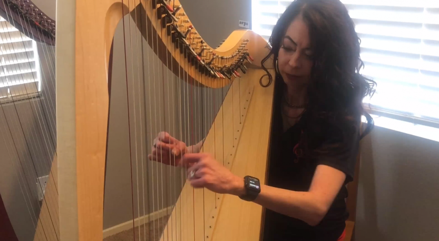 Music Department Chair Dr. Jennifer Garrett as she plays the harp.