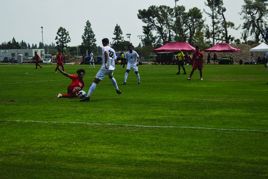 Aug 31 Bakersfield College center midfielder Anthony Miron (10) slides and makes contact with the ball near midfield in the first half.