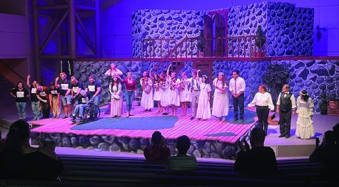 """The cast of """"A Midsummer Night's Dream"""" take a bow on stage for their curtain call on opening night."""