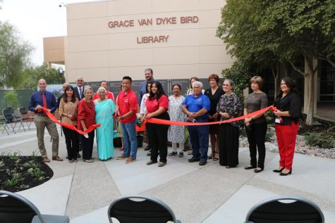 The ceremonial ribbon is cut during the grand opening of The Learning Garden in front of the Grace Van Dyke Bird Library on Oct. 4.